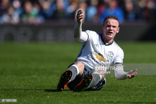 Manchester United's English striker Wayne Rooney gestures during the English Premier League football match between Burnley and Manchester United at...