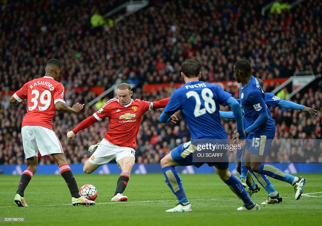 Manchester United's English striker Wayne Rooney (L) has a shot but misses the target during the English Premier League football match between Manchester United and Leicester City at Old Trafford in Manchester, north west England, on May 1, 2016. / AFP / OLI SCARFF / RESTRICTED TO EDITORIAL USE. No use with unauthorized audio, video, data, fixture lists, club/league logos or 'live' services. Online in-match use limited to 75 images, no video emulation. No use in betting, games or single club/league/player publications. /