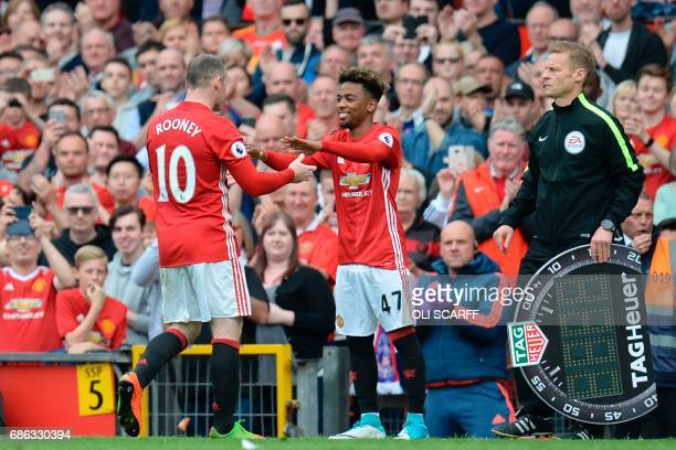 Manchester United's English striker Wayne Rooney is substituted for Manchester United's English midfielder Angel Gomes during the English Premier...