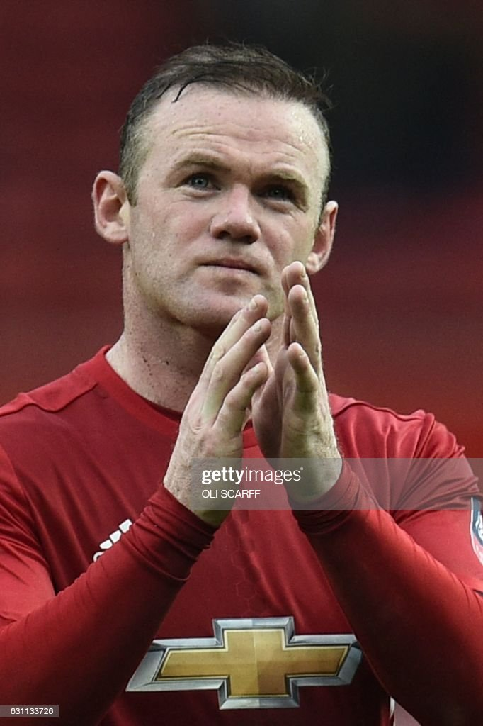 Manchester United's English striker Wayne Rooney leaves the field at the end of the English FA Cup third round football match between Manchester United and Reading at Old Trafford in Manchester, north west England, on January 7, 2017. / AFP / Oli SCARFF / RESTRICTED TO EDITORIAL USE. No use with unauthorized audio, video, data, fixture lists, club/league logos or 'live' services. Online in-match use limited to 75 images, no video emulation. No use in betting, games or single club/league/player publications. /