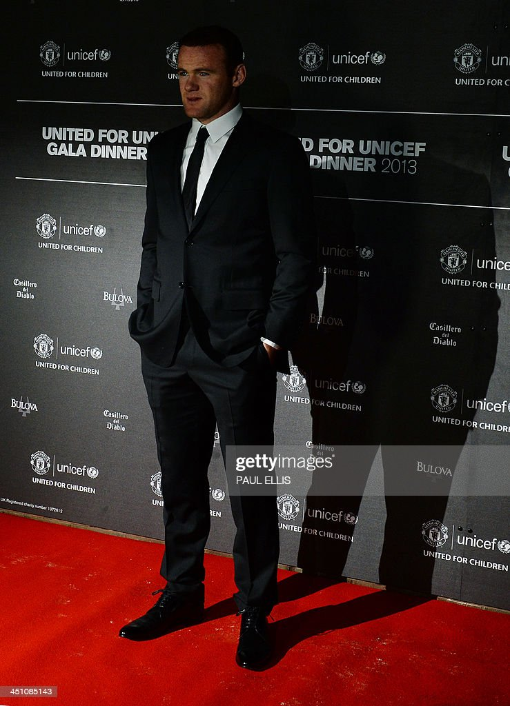 Manchester United's English striker Wayne Rooney poses for photographs as he arrives for a gala dinner in aid of UNICEF at Old Trafford in Manchester on November 21, 2013.