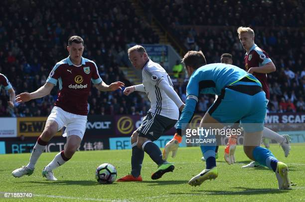 Manchester United's English striker Wayne Rooney scores during the English Premier League football match between Burnley and Manchester United at...