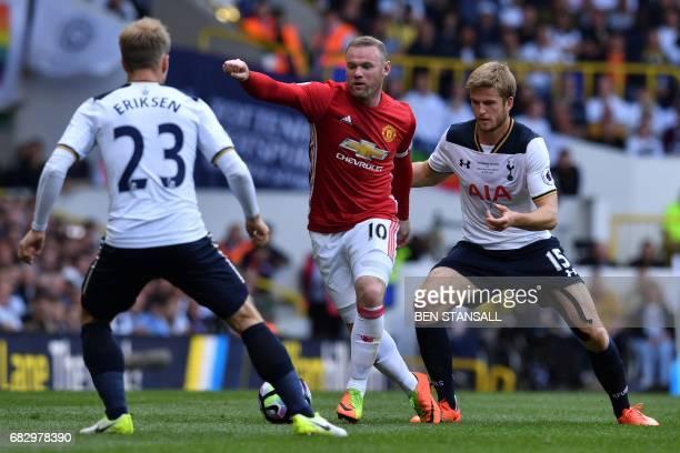Manchester United's English striker Wayne Rooney vies with Tottenham Hotspur's Danish midfielder Christian Eriksen and Tottenham Hotspur's English...