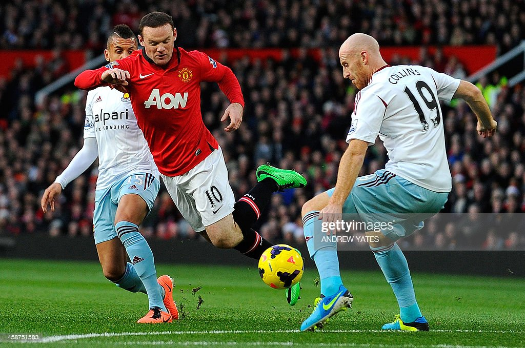 Manchester United's English striker Wayne Rooney (C) vies with West Ham United's English midfielder Ravel Morrison (L) and West Ham United's Welsh defender James Collins (R) during the English Premier League football match between Manchester United and West Ham United at Old Trafford, Manchester, northwest England, on December 21, 2013. Manchester United won 3-1. USE. No use with unauthorized audio, video, data, fixture lists, club/league logos or live services. Online in-match use limited to 45 images, no video emulation. No use in betting, games or single club/league/player publications.