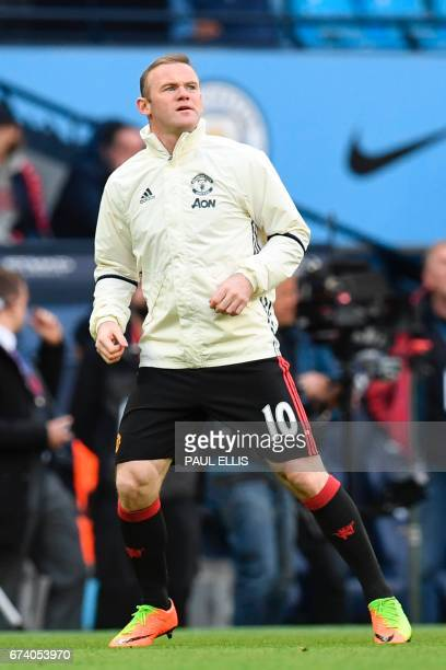 Manchester United's English striker Wayne Rooney warms up ahead of the English Premier League football match between Manchester City and Manchester...