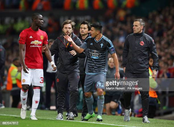 Manchester United's Eric Bailly and Celta Vigo's Facundo Roncaglia exchange words after both being sent off during the UEFA Europa League Second Leg...
