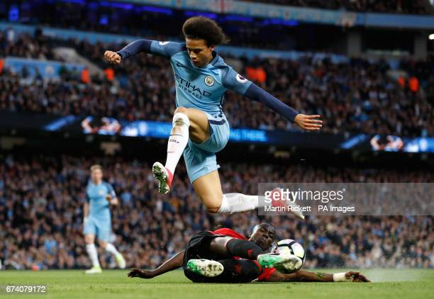 Manchester United's Eric Bailly and Manchester City's Leroy Sane battle for the ball during the Premier League match at the Etihad Stadium Manchester