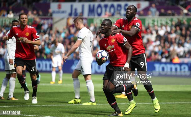 Manchester United's Eric Bailly celebrates scoring his side's first goal of the game with team mate Romelu Lukaku during the Premier League match at...