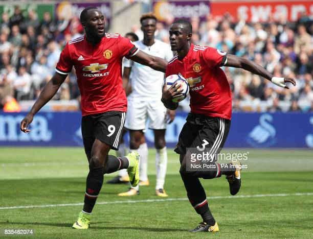 Manchester United's Eric Bailly celebrates with teammate Romelu Lukaku after scoring his side's first goal during the Premier League match at the...