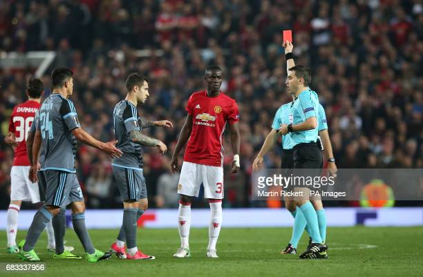 Manchester United's Eric Bailly is shown a red card along with Celta Vigo's Facundo Sebastian Roncaglia after an altercation