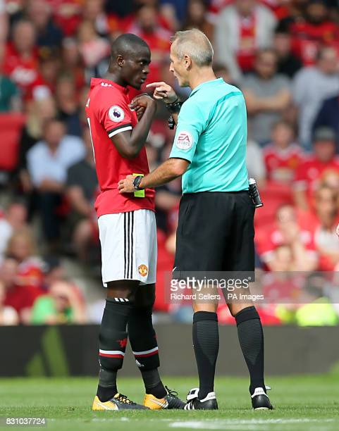Manchester United's Eric Bailly is shown the yellow card by referee Martin Atkinson during the Premier League match at Old Trafford Manchester