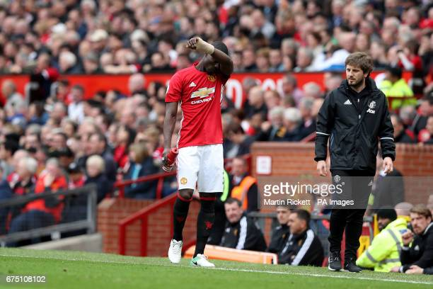 Manchester United's Eric Bailly leaves the game with an injury during the Premier League match at Old Trafford Manchester