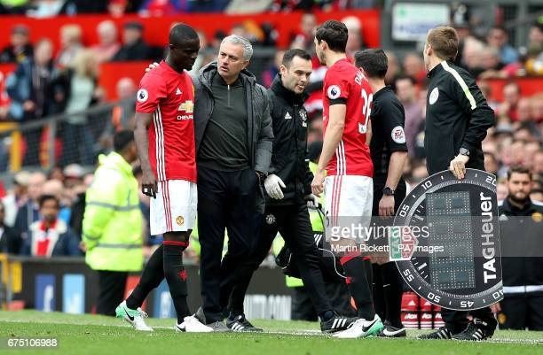 Manchester United's Eric Bailly leaves the game with an injury alongside Manchester United manager Jose Mourinho and Manchester United's Matteo...