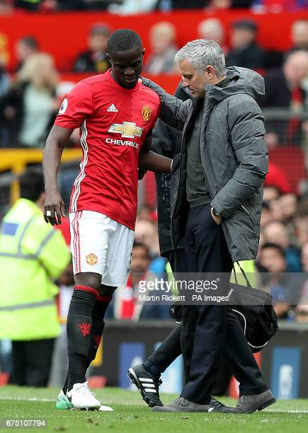 Manchester United's Eric Bailly with Manchester United manager Jose Mourinho as he leaves the game with an injury during the Premier League match at...