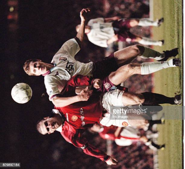 Manchester United's Eric Cantona battles with Aston Villa's Carl Tiler during their 00 draw at Old Trafford Photo by Dave Kendall