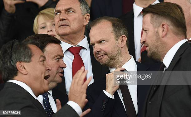Manchester United's executive vicechairman Ed Woodward awaits kickoff ahead of the English Premier League football match between Manchester United...