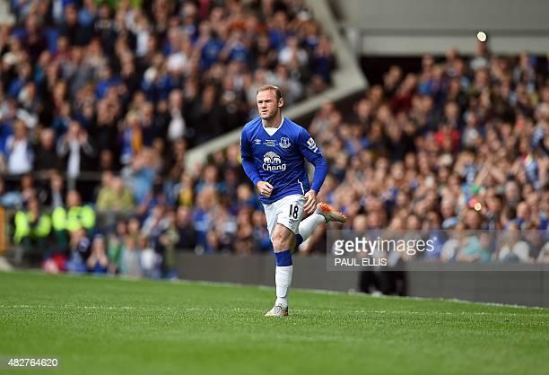 Manchester United's former Everton forward Wayne Rooney comes on during the Duncan Ferguson Testimonal preseason friendly football match between...