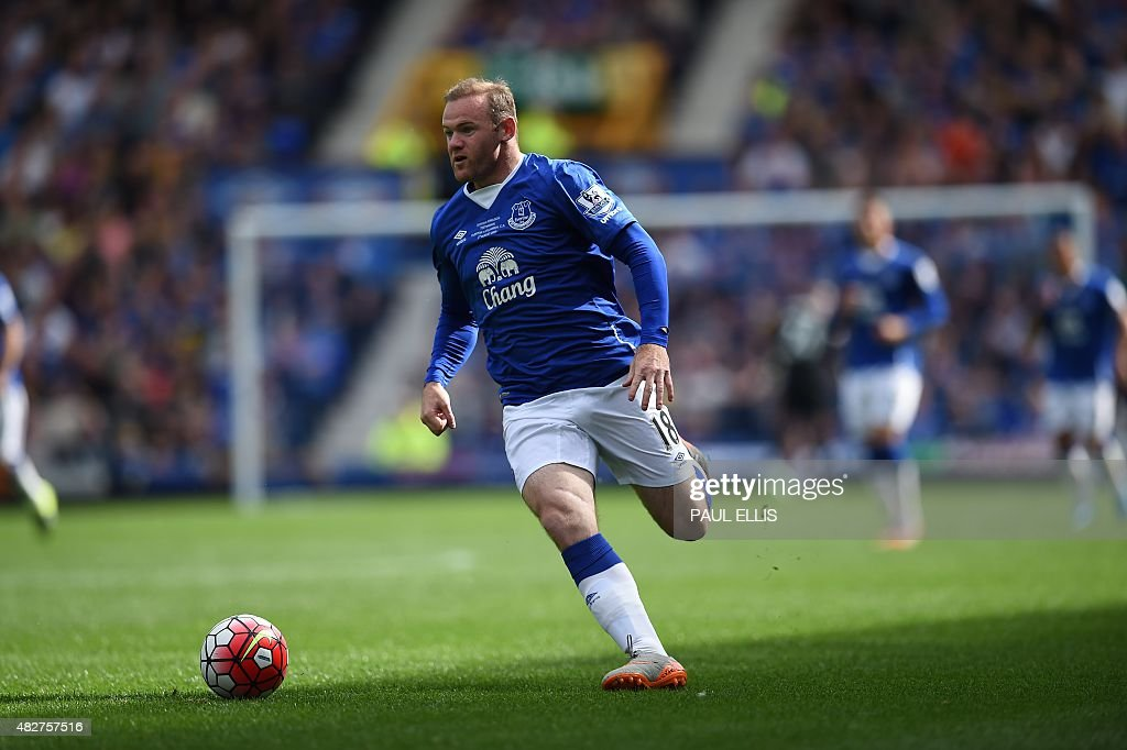 Manchester United's former Everton forward Wayne Rooney runs with the ball during the Duncan Ferguson Testimonal pre-season friendly football match between Everton and Villarreal at Goodison Park in Liverpool, north west England on August 2, 2015. USE. No use with unauthorised audio, video, data, fixture lists, club/league logos or live services. Online in-match use limited to 45 images, no video emulation. No use in betting, games or single club/league/player publications.