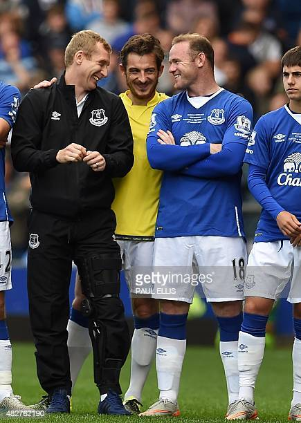 Manchester United's former Everton forward Wayne Rooney shares a joke with Everton's Leighton Baines and Tony Hibbert after the Duncan Ferguson...