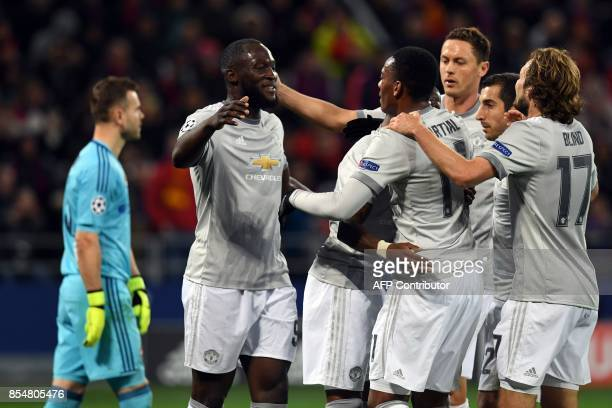 Manchester United's forward from Belgium Romelu Lukaku celebrates with teammates after scoring his team's third goal as CSKA Moscow's goalkeeper from...