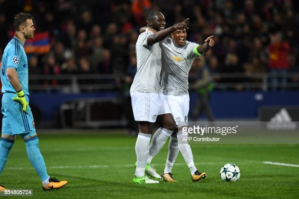 Manchester United's forward from Belgium Romelu Lukaku celebrates with Manchester United's midfielder from England Ashley Young after scoring his...
