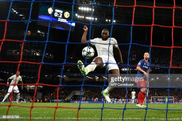 Manchester United's forward from Belgium Romelu Lukaku scores his team's third goal during the UEFA Champions League Group A football match between...