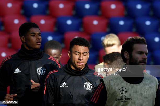 Manchester United's forward from England Marcus Rashford Manchester United's midfielder from England Jesse Lingard and Manchester United's midfielder...