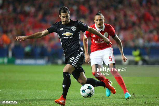 Manchester United's forward Henrikh Mkhitaryan vies with Benfica's midfielder Ljubomir Fejsa during the Champions League football match between SL...