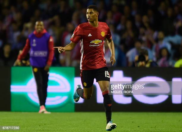 Manchester United's forward Marcus Rashford celebrates after scoring the opener during their UEFA Europa League semi final first leg football match...