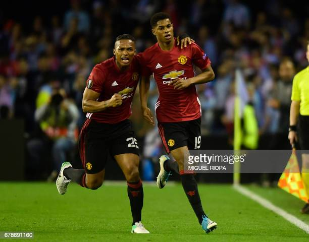 Manchester United's forward Marcus Rashford celebrates with his teammate Ecuadorian defender Antonio Valencia after scoring during their UEFA Europa...