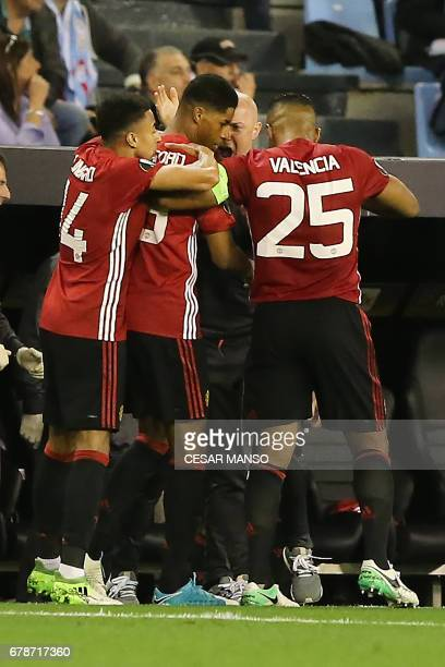 Manchester United's forward Marcus Rashford celebrates with teammates after scoring the opener during their UEFA Europa League semi final first leg...