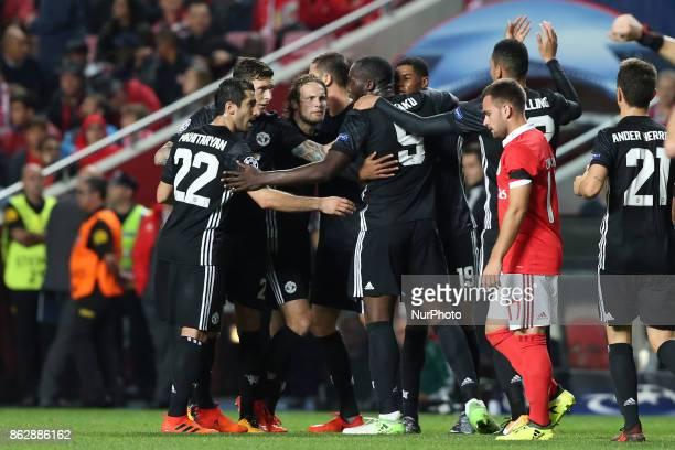 Manchester United's forward Marcus Rashford celebrates with teammates after scoring during the UEFA Champions League football match SL Benfica vs...