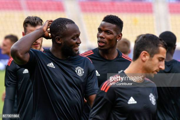 Manchester United's forward Romelu Lukaku and midfielder Paul Pogba react as they warm up during a training session ahead of the UEFA Super Cup 2017...