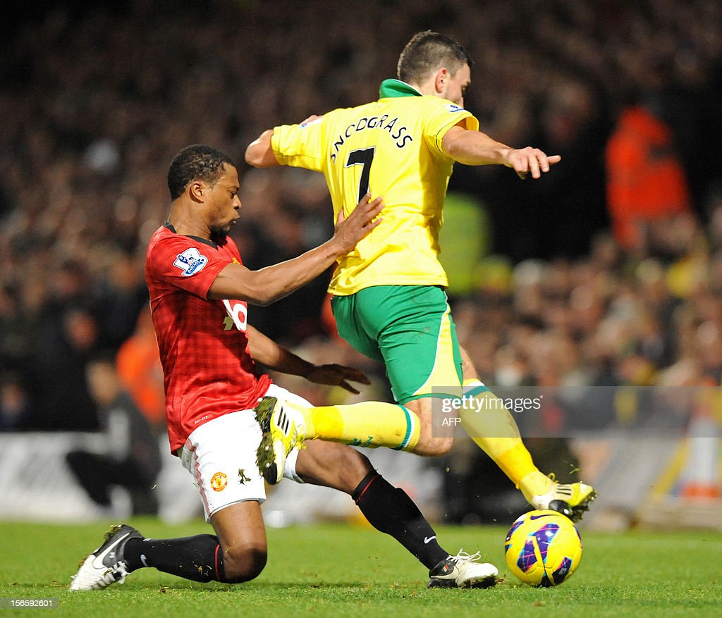 "Manchester United's French defender Patrice Evra (L) vies with Norwich City's Scottish striker Robert Snodgrass (R) during the English Premier League football match between Norwich City and Manchester United at Carrow Road stadium in Norwich, England on November 17, 2012. Norwich City won the game 1-0. USE. No use with unauthorized audio, video, data, fixture lists, club/league logos or ""live"" services. Online in-match use limited to 45 images, no video emulation. No use in betting, games or single club/league/player publications."