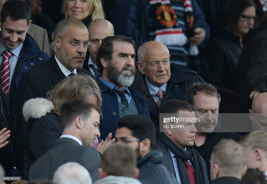 Manchester United's French former player Eric Cantona (C) arrives to watch the English Premier League football match between Manchester United and Leicester City at Old Trafford in Manchester, north west England, on May 1, 2016. / AFP / OLI SCARFF / RESTRICTED TO EDITORIAL USE. No use with unauthorized audio, video, data, fixture lists, club/league logos or 'live' services. Online in-match use limited to 75 images, no video emulation. No use in betting, games or single club/league/player publications. /