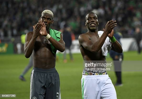 Manchester United's French midfielder Paul Pogba and his brother SaintEtienne's Guinean defender Florentin Pogba greet supporters at the end of the...