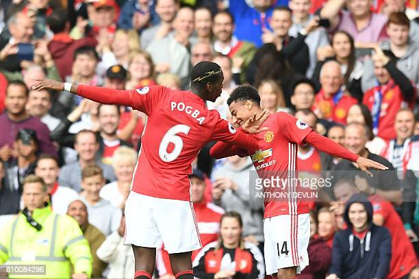 Manchester United's French midfielder Paul Pogba and Manchester United's English midfielder Jesse Lingard celebrate after Pogba scored their fourth...