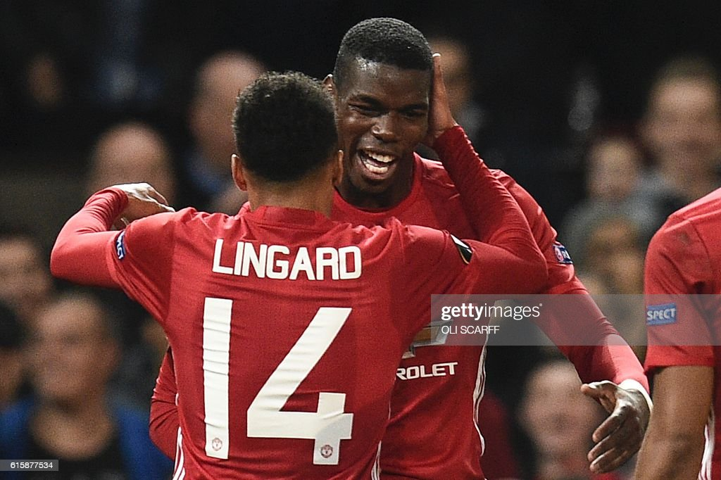 Manchester United's French midfielder Paul Pogba (R) and Manchester United's English midfielder Jesse Lingard (L) celebrate after Pogba scored their third goal during the UEFA Europa League group A football match between Manchester United and Fenerbahce at Old Trafford in Manchester, north west England, on October 20, 2016. / AFP / OLI