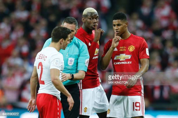 Manchester United's French midfielder Paul Pogba and Manchester United's English striker Marcus Rashford gesture to Southampton's Germanborn...