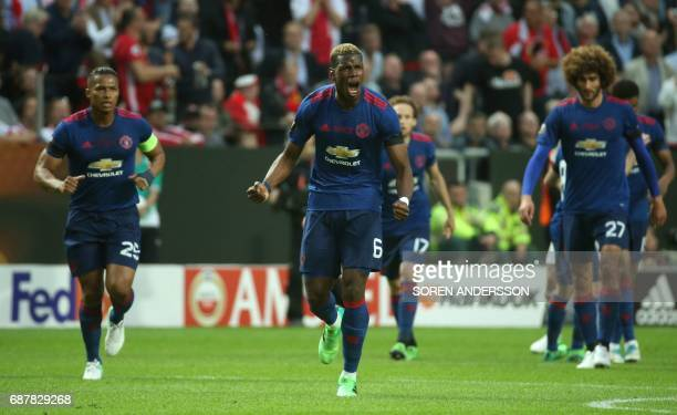 Manchester United's French midfielder Paul Pogba celebrates after scoring during the UEFA Europa League final football match Ajax Amsterdam v...