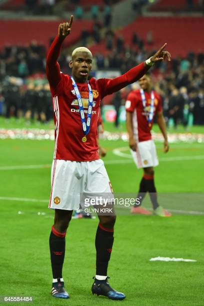 Manchester United's French midfielder Paul Pogba celebrates on the pitch after their victory in the English League Cup final football match between...