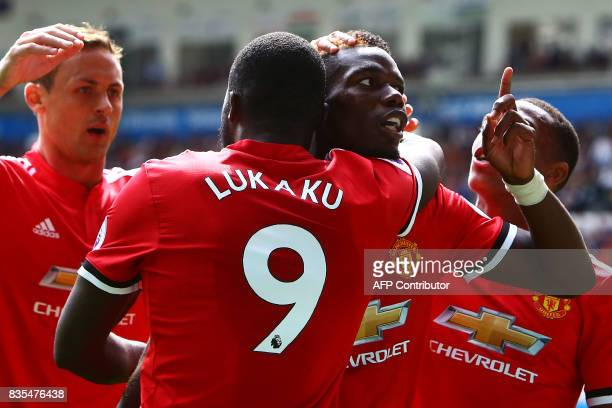 Manchester United's French midfielder Paul Pogba celebrates with Manchester United's Belgian striker Romelu Lukaku scoring the team's fourth goal...