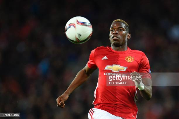 Manchester United's French midfielder Paul Pogba chases the ball during the UEFA Europa League quarterfinal second leg football match between...