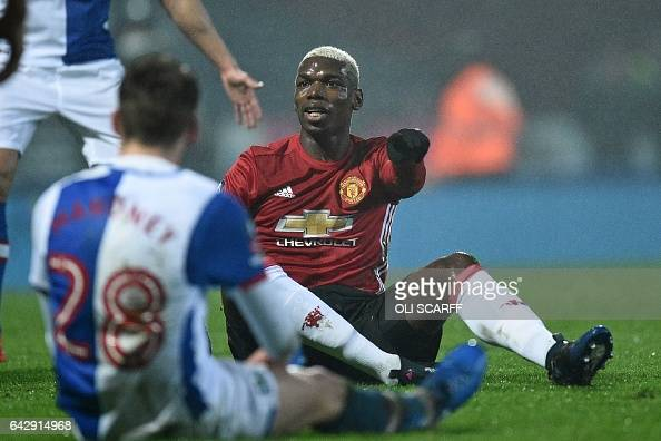 Manchester United's French midfielder Paul Pogba gestures after fouling Blackburn Rovers' English midfielder Connor Mahoney during the English FA Cup...