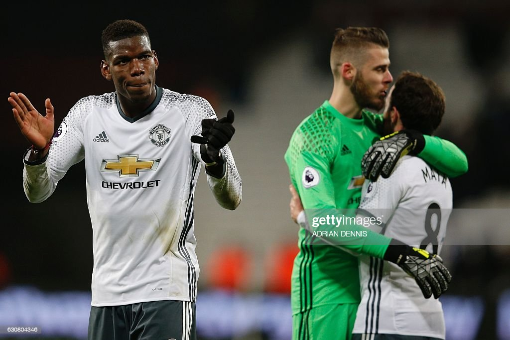 Manchester United's French midfielder Paul Pogba (L), Manchester United's Spanish goalkeeper David de Gea and Manchester United's Spanish midfielder Juan Mata (R) celebrate their win on the pitch after the English Premier League football match between West Ham United and Manchester United at The London Stadium, in east London on January 2, 2017. Manchester United won the game 2-0. / AFP / Adrian DENNIS / RESTRICTED TO EDITORIAL USE. No use with unauthorized audio, video, data, fixture lists, club/league logos or 'live' services. Online in-match use limited to 75 images, no video emulation. No use in betting, games or single club/league/player publications. /