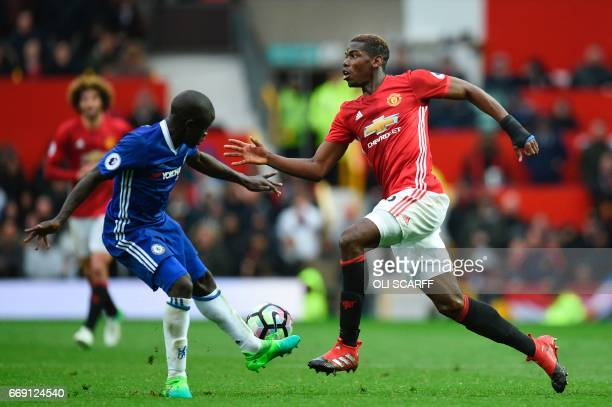 Manchester United's French midfielder Paul Pogba takes on Chelsea's French midfielder N'Golo Kante during the English Premier League football match...