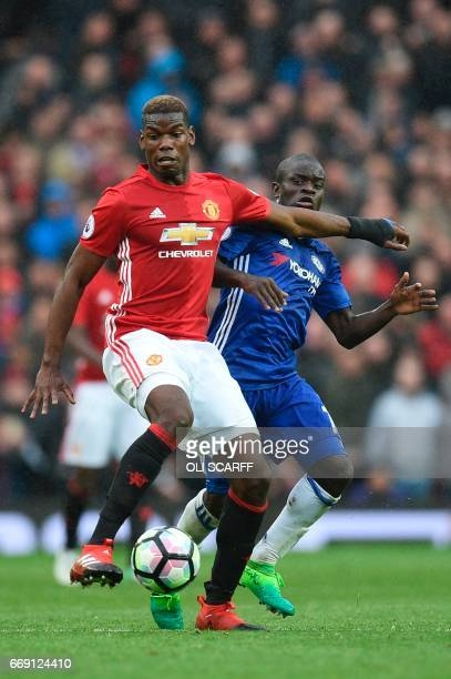 Manchester United's French midfielder Paul Pogba tries to hold off Chelsea's French midfielder N'Golo Kante during the English Premier League...