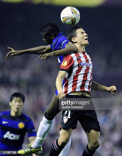 Manchester United's French midfielder Paul Pogba vies with Athletic Bilbao's midfielder Ander Herrera during the UEFA Europa round of 16 second leg...