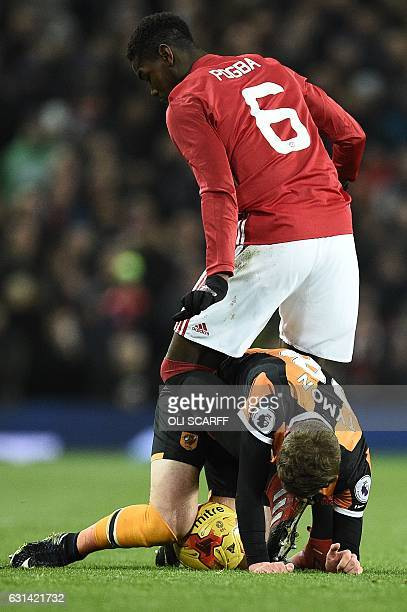 Manchester United's French midfielder Paul Pogba vies with Hull City's English defender Josh Tymon during the EFL Cup semifinal football match...