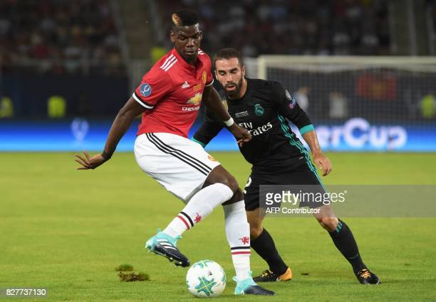 Manchester United's French midfielder Paul Pogba vies with Real Madrid's Spanish defender Dani Carvajal during the UEFA Super Cup football match...